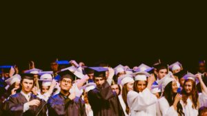 Students wearing cap and gown at graduation